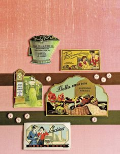 antique needle books on display on a wall