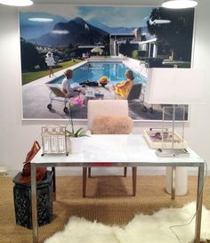 "Our customer Stayci Fast uploaded an image of her new office onto our facebook page! We think the Surface View canvas from our Slim Aaron image collection titled ""Poolside Gossip"" looks fantastic and makes this office an ideal place to work :)"