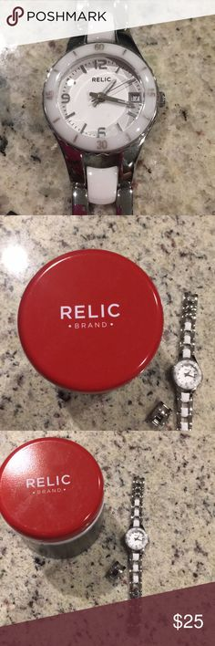Relic brand watch Flawless Relic Watch. Worn twice. Stored in case it was purchased in. Received as a gift. Don't care for color in my watches (white, in this case). Relic Accessories Watches