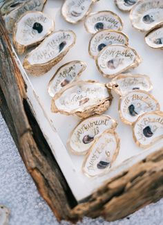 Calligraphy written on oyster geode wedding escort cards #escortcards #beachwedding #summerweddingideas