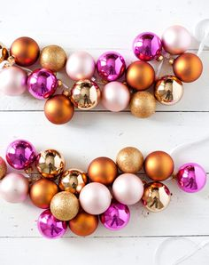DIY ornament garland. Get this and more simple and gorgeous new year's party craft and decoration ideas. #nye #newyearscrafts #decorations #decorideas #nyecrafts