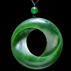 A hand crafted jade mobius disc wearable art necklace by Omni Caeon Le Jade, Maori Symbols, Polynesian Art, Jewelry Design Earrings, Crystal Magic, Bone Carving, Wooden Jewelry, Gems And Minerals, Stone Painting