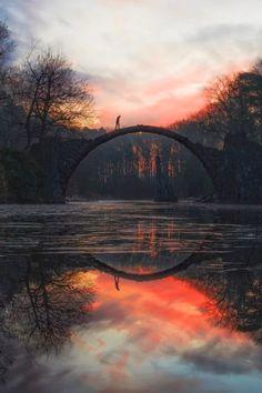 Sunset at  Rakotz Bridge  in The Azalea and Rhododendron Park Kromlau - Kromlau village, Gablentz municipality, Saxony, Germany