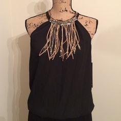 [BOUTIQUE] sleeveless blouse with fringe neckline Boutique sleeveless blouse with fringe neckline // NWT // (2) - 1 size small; 1 size large // beautiful fringe detail // halter neck // if interested, I'll create a separate listing - please do not purchase this one. Boutique Tops