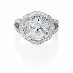 This amazing antique style 18k white gold engagement ring setting, features 2 shield cut and 96 round brilliant cut white diamonds of F color, VS2 clarity and excellent cut and brilliance, weighing 1.16 carats total. There is extensive milgrain detailing along the shank.