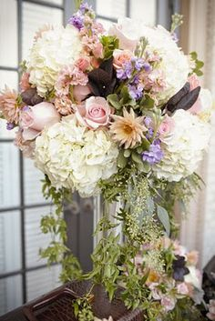 nice flow to this arrangement. Colors need to be more intense shades of peach