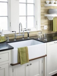 fireclay apron front sink and black countertops, love the tile choice