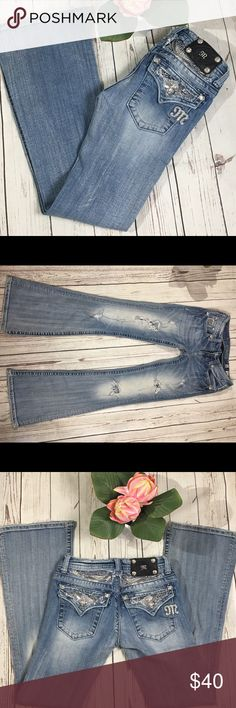 Miss me flare jeans stud bling flap pockets 26x33 Miss Me flare distressed jeans size 26x33 bling stud back flap pockets. Jeans have slight discoloration on back hem and a small spot on front near the holes. These are not noticeable unless you are looking for them under a light. Miss Me Jeans Flare & Wide Leg