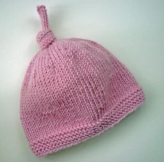 Baby Hat with Top Knot - free knitting pattern.