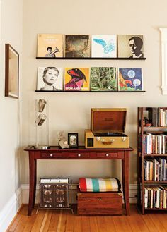 Records displayed on shelves above record player