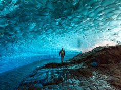 The ice caves inside Juneau's Mendenhall Glacier are not easily accessible nor for the faint of heart—those who want to see them in person must first kayak to the glacier and then ice-climb to reach it. But once adventurers stand under the glowing blue ceilings of ice, we're pretty sure they'll tell you it's worth the trek.