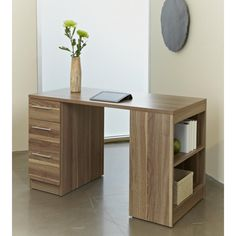 This beautiful contemporary study desk by Jesper is made of a durable, solid wood & Laminate construction in a warm shade of walnut. The bookshelf on the side adds extra space for easy organization and storage, making your work space even more functional.