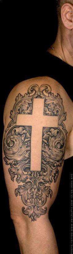 simple white cross tattoo on shoulder for men - Tattoo for men