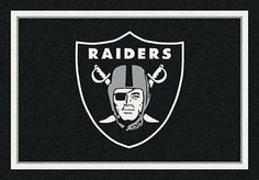 """Oakland Raiders 3' 10"""" x 5' 4"""" Team Spirit Area Rug (Black) by Milliken. $109.00. Get in the Game with this NFL Oakland Raiders Team Spirit area rug from Milliken and Company - the leader in textile research and design. Made of injected dyed 100% Stainmaster Nylon, coated backing and serged borders. Ideal for the home or office. Crafted with Pride in the USA. ¶¶Rug Dimensions: 3' 10"""" x 5' 4""""¶To view all the Milliken Area Rugs available for this team please click here.¶..."""