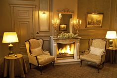Share an aperitif before a delicious #epicurean dinner!  Our lobby features a beautiful #fireplace in our historic Hotel Heritage #bruges