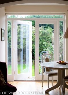 Silky white painted wooden French doors and frame. All fully double glazed. Double Glass Doors, Double French Doors, French Windows, Modern Patio Doors, French Doors Patio, Double Patio Doors, French Doors With Sidelights, Windows And Doors, Door With Window