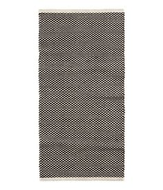 Laundry room ?  White/charcoal gray. Rectangular rug in cotton fabric with a jacquard-weave pattern.