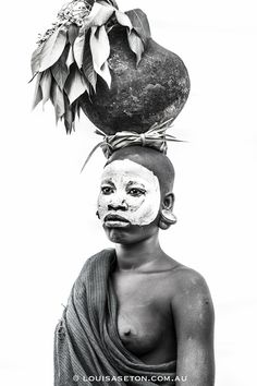 The Surma people are made up of the Suri tribe and the Mursi tribe. These images were taken in Ethiopia by Louisa Seton, who wanted to photograph them before they disappeared. Portraits, Portrait Photographers, African Wall Art, Mursi Tribe, Human Body Art, African Girl, African Beauty, African Women, Extraordinary People