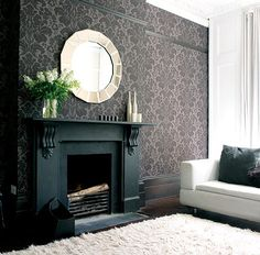 It's a look that is gaining popularity recently - painting floors, fireplaces and moldings a dramatic black. We think the example from Inspace show above looks super, but wonder if we'd have the guts to take a black-covered brush to these details in our own home....would you? (yes, yes I would...)