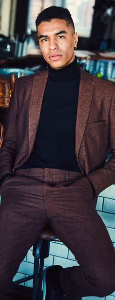 A dark colored suit with a black turtleneck is the perfect combination for  your outfit for the New Years eve party