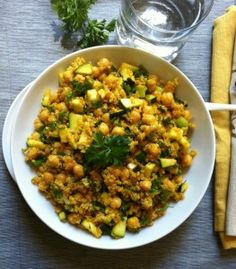Zucchini Chickpea Quinoa Salad mixes zucchini, fresh parsley, green onions and chickpeas with a spiced olive oil dressing.  This salad has the rich, warm flavors of cumin, turmeric and paprika and offers protein. // A Cedar Spoon