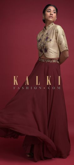Buy Online from the link below. We ship worldwide (Free Shipping over US$100)  Click Anywhere to Tag Maroon Skirt And Beige Crop Top With Embroidered Floral Pattern Online - Kalki Fashion Maroon skirt in georgette with zardozi embroidered waist.Paired with a beige crop top in raw silk.Adorned with thread and zardozi embroidered floral pattern.