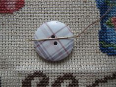 Never lose a needle again! This beautiful brown/purple plaid needle minder is made with wooden buttons and strong magnets! The back magnet Needle Minders, Magnets, Strong, Plaid, Buttons, Purple, Brown, Beautiful, Gingham