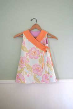 Criss cross reversible Easter dress in Amy Butler tutorial. Pink and coral.