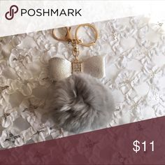 New Real Rabbit Fur Pom Pom Keychain Handbag Decor New never used. Has a bow with rhinestones on it. Can use as a keychain or hang it on your handbag. I have a few of these in different colors listed. Accessories Key & Card Holders