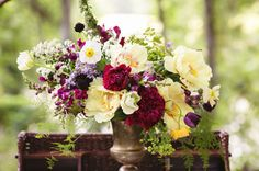 love the yellow peonies in this stunning floral display