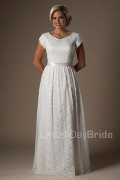 The Peregrine | Find your dream wedding dress at your dream price! This lovely modest wedding gown features a stunning lace pattern, soft v-neckline, cinched waistband and a gently pleated A-line skirt.    Gown available in Ivory or White.    *Gown pictured in Ivory    Sleeve length or neckline can be customized. Please call for more information.    Available at LatterDayBride.com or in Store Located in Salt Lake City, Utah