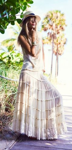 Denim & Supply featured in Elle Norge: a tiered maxi skirt and loose tank create the perfect outfit for a tropical getaway.