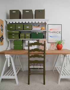 I want a desk like this! So organized! So simple! I already have several storage boxes like this, and while my desk isn't quite so airy, it could still work. I feel some inspiration coming on ...