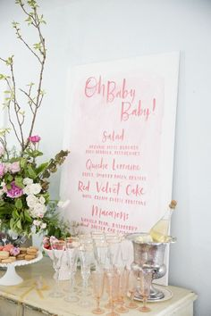 Floral themed baby shower inspiration - Love the way they styled this cocktail bar with an oversize menu