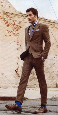 James Marsden. tweed suit. Swap blue socks for red argyle. and brown tie for something orange.