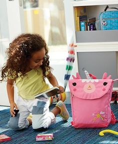 Showing up at school with a wild animal on your back may sound like a bad idea. But take a look at this unicorn kids backpack designed for us by artist Michelle Romo, and you'll think twice. It features roomy compartments and padded straps that make it great for carrying all your school supplies.