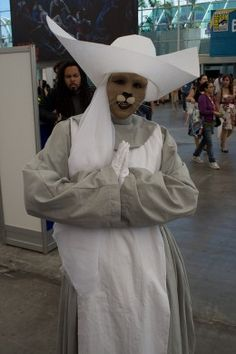 Catkind nurse costume breakdown:  * A nun outfit (the kind with the AWESOME flying nun habit)  * Face paint  * Prosthetics for below your nose for a convincing cat mouth  * Whiskers (if you want to go all the way)  * White gloves