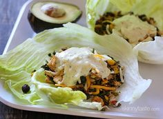Turkey Santa Fe Lettuce Wraps Recipe Main Dishes with olive oil, red bell pepper, scallions, turkey breast, frozen corn, black beans, frozen spinach, jalapeno chilies, cumin, chili powder, kosher salt, Mexican cheese blend, lettuce leaves, ranch dressing
