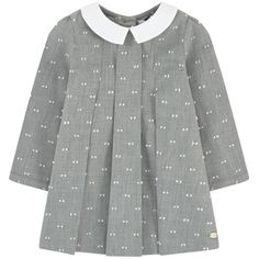 Dress: Cotton fabric Collar: Cotton poplin Flared dress Without lining Contrast collar Flat pleats on the chest Very flared bottom Long sleeves Buttons on the cuffs Buttons in the back Pearly logo buttons Embroidered dots - $ 100