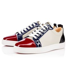 """For those who prefer to keep a low profile, """"Louis Junior Flat"""" is your gateway into the world of Louboutin. In a sharp and sober blend of leather, patent, specchio and calf caviar, this lowtop sneaker gets you from A to B in ultra-comfortable, unmistakable Louboutin style."""