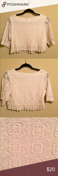 Cream crop top Cream lace crop top never worn before! Hits at belly button. Tops Crop Tops