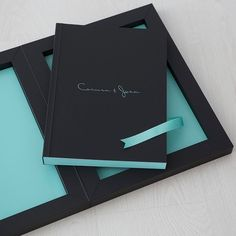 From the Spanish photographer Adolfo Enriquez, a #youngbook in black soft touch and details in the iconic blue Tiffany. #graphistudio #weddingbook #weddingphotography #madeinitaly
