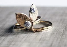 Golden leaves set with diamond drops.
