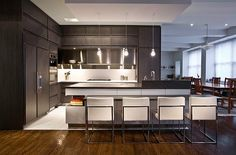 Dark modern corner kitchen furniture with white accents    A luxurious addition to a stunning home. Timeline is a new signature kitchen collection from Aster Cucine, one of the European leaders in innovative kitchen design – by Urban Homes: Kitchen Remodel: 101 Stunning Ideas for Your Kitchen Design