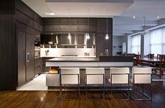 Dark modern corner kitchen furniture with white accents    A luxurious addition…