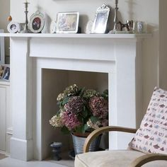 Beautiful white traditional fireplace filled with an hydrangea flower arrangement rather than candles or a log burner. How to style a fireplace without a fire. Empty Fireplace Ideas, Wooden Fireplace Surround, Unused Fireplace, Dining Room Fireplace, Simple Fireplace, Victorian Fireplace, Home Fireplace, Faux Fireplace, Fireplace Surrounds