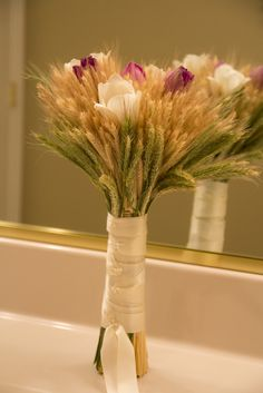 Wedding bouquet with wheat, tulips and ribbon. The tulips could easily be replaced with roses.