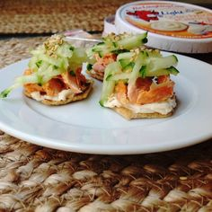 Salmon, cucumber, and laughing cow cheese on a cracker
