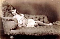Postmortem photo of a young girl, beautiful layed down on a chaise-longue, as if she's asleep.