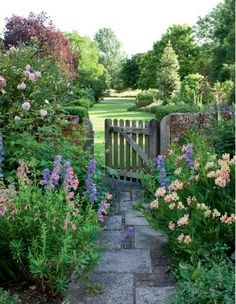 A pretty cottage garden thru the gate to green open space....................